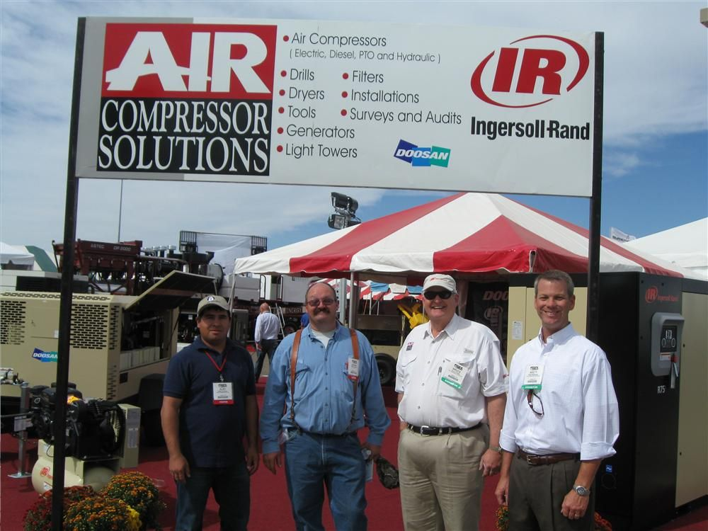 (L-R): Alby Enriquez and Dennis White of Allied Oil Field in Denver City, Texas, take a photo op with Bruce Peeler and Brett Ridgeway of Air Compression Solutions in Odessa, Texas.