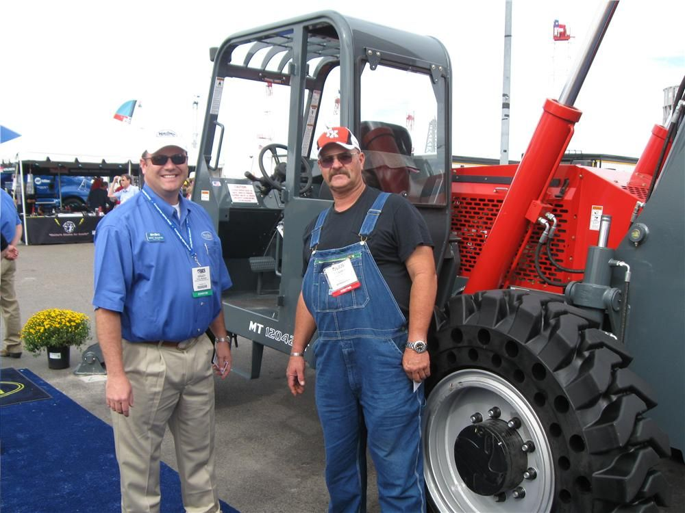 Brady McAllister (L) of Kirby-Smith Machinery, Inc., has been explaining the attributes of this Manitou MT 12042 XT to Tommy Miller, Reveal Fishing Tools in Rankin, Texas.