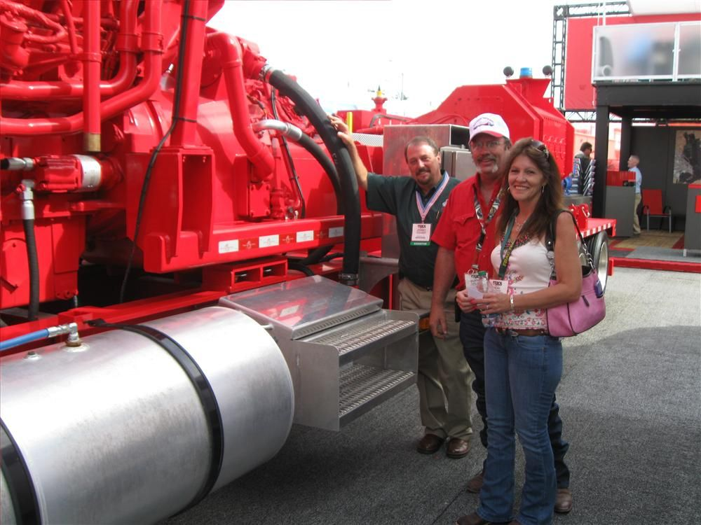 (L-R): Johnny Aguilar, Dragon Products, Cutter and Vicki Carroll of Comanche Services in Goldsmith, Texas, take a photo op with the Dragon 2,500 hp (1,864 kW) mobile frac pumping unit.