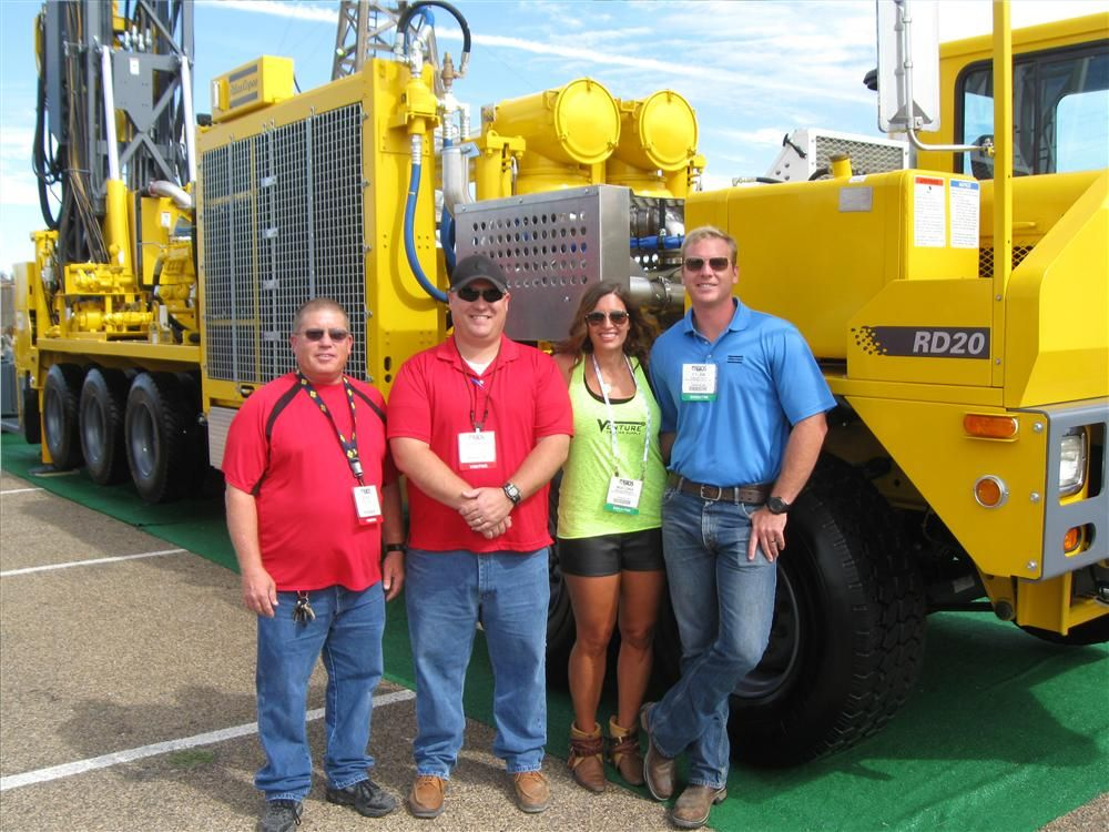 (L-R): Berry Ingram and Stephen Slocumb of Capstar Drilling in Odessa, Texas, catch up with Nocona and Tyler Williams, Venture Drilling Supply LLC in Tahlequah, Okla., and the Atlas Copco RD 20 XC mobile oil and gas drilling rig.
