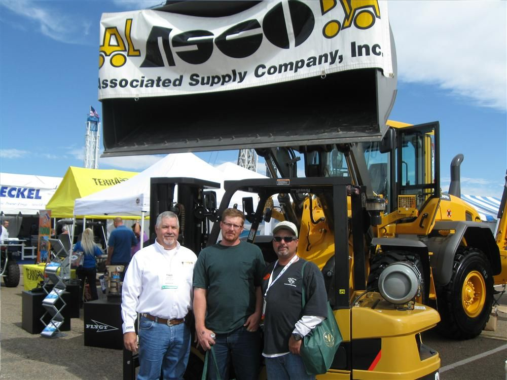 (L-R): Brent Tankersley, ASCO in Amarillo, Texas, has just given James O. Rudd and Albert Espinoza of Control Systems in Broussard, La., a rundown on the Cat 2P 5000 lift truck.