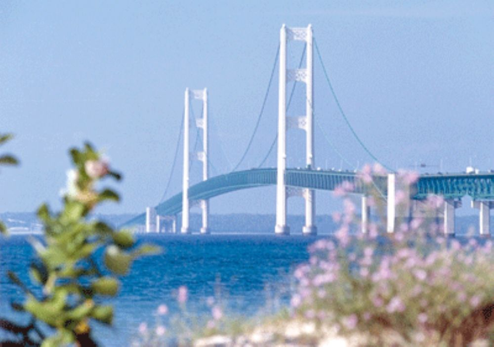 """Observing its 50th anniversary this year, the """"Mighty Mac,"""" in Michigan, is one of the nation's greatest bridge- building achievements of the 20th century."""