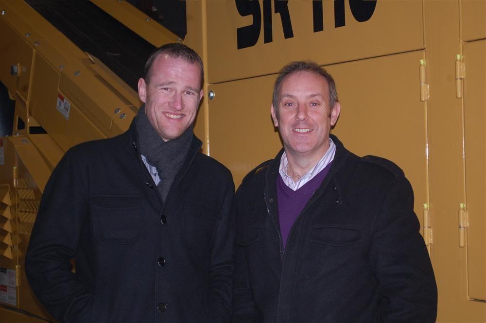 With an Anaconda SR410 is Alistair Forsyth (L), managing director of Anaconda Equipment International Ltd., and Eamon McMahon, president of Anaconda USA.