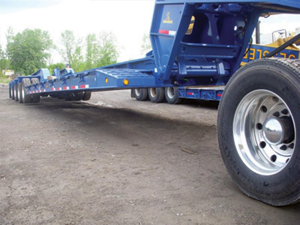 The CobraNeck is currently available on all ROGERS's 55-ton (50 t) and larger detachable gooseneck trailers.