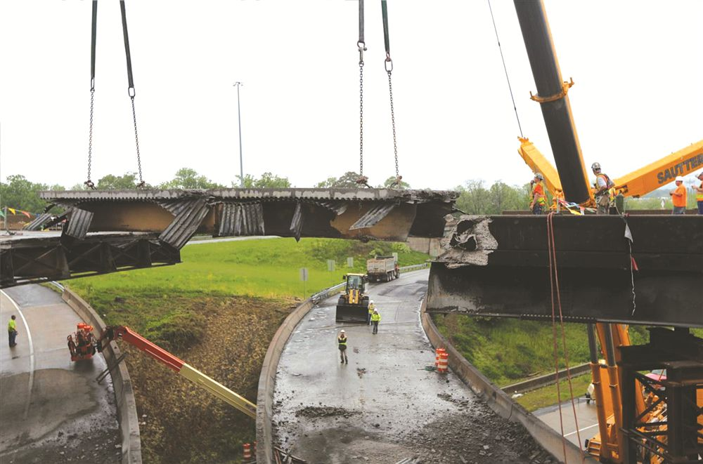 The first section of the eastbound Route 22 bridge over I-81 was picked up and trucked to a separate location for dismantling.
