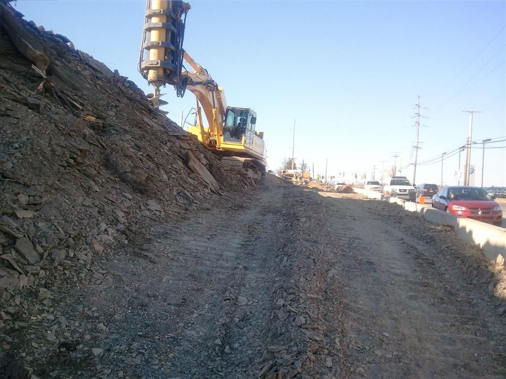 Golden Triangle used their LoDril attachment to drill for the caissons in the upcoming retaining wall.