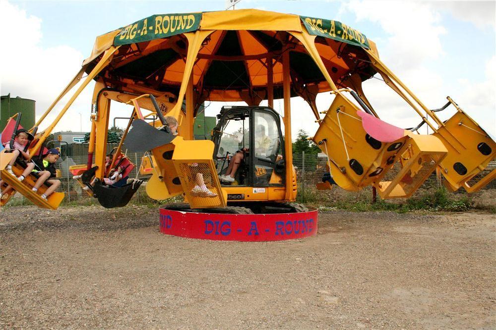 DiggerlandUSA.com photo Kids spin around and around in this modified JCB excavator.