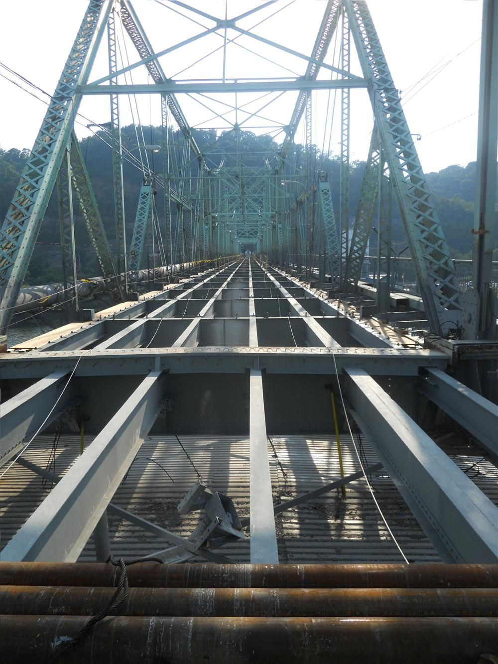 The contract calls for rehabilitation of the 10-span bridge, including deck and sidewalk replacement, steel repairs, concrete spall repairs, structural steel painting, new parapet walls, railing repairs, bituminious paving patching, pavement markings and