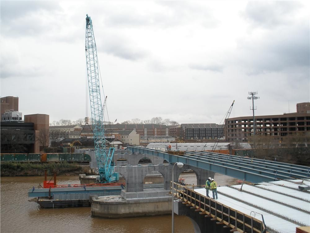 The new construction includes a multi-span bridge, with reinforced concrete piers, abutments and retaining walls, all supported on approximately 22,000 linear feet of 14 x 102 piles. Span 10 steel erection is shown here.