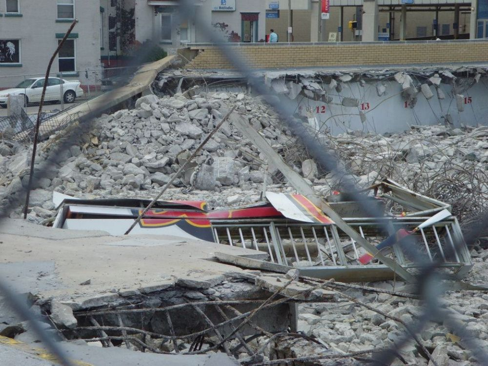 Photo courtesy of the Erie Otters Hockey Club. A close-up of demolished message board sign on East 9th Street.