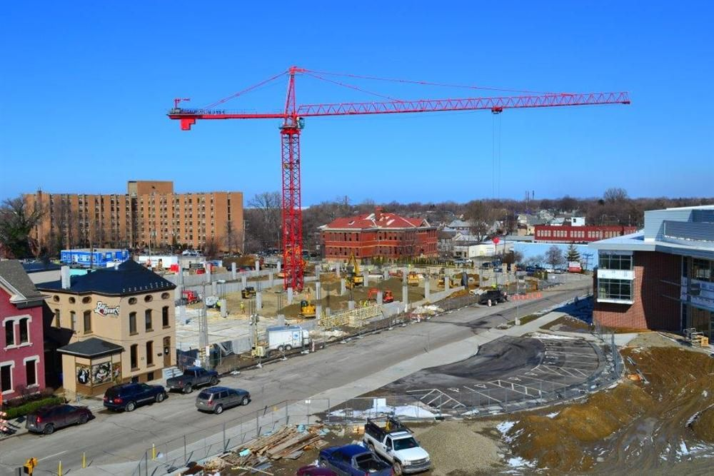 Photo courtesy of the Erie Otters Hockey Club. A tower crane works on the parking garage project, which is being done by Erie Insurance.