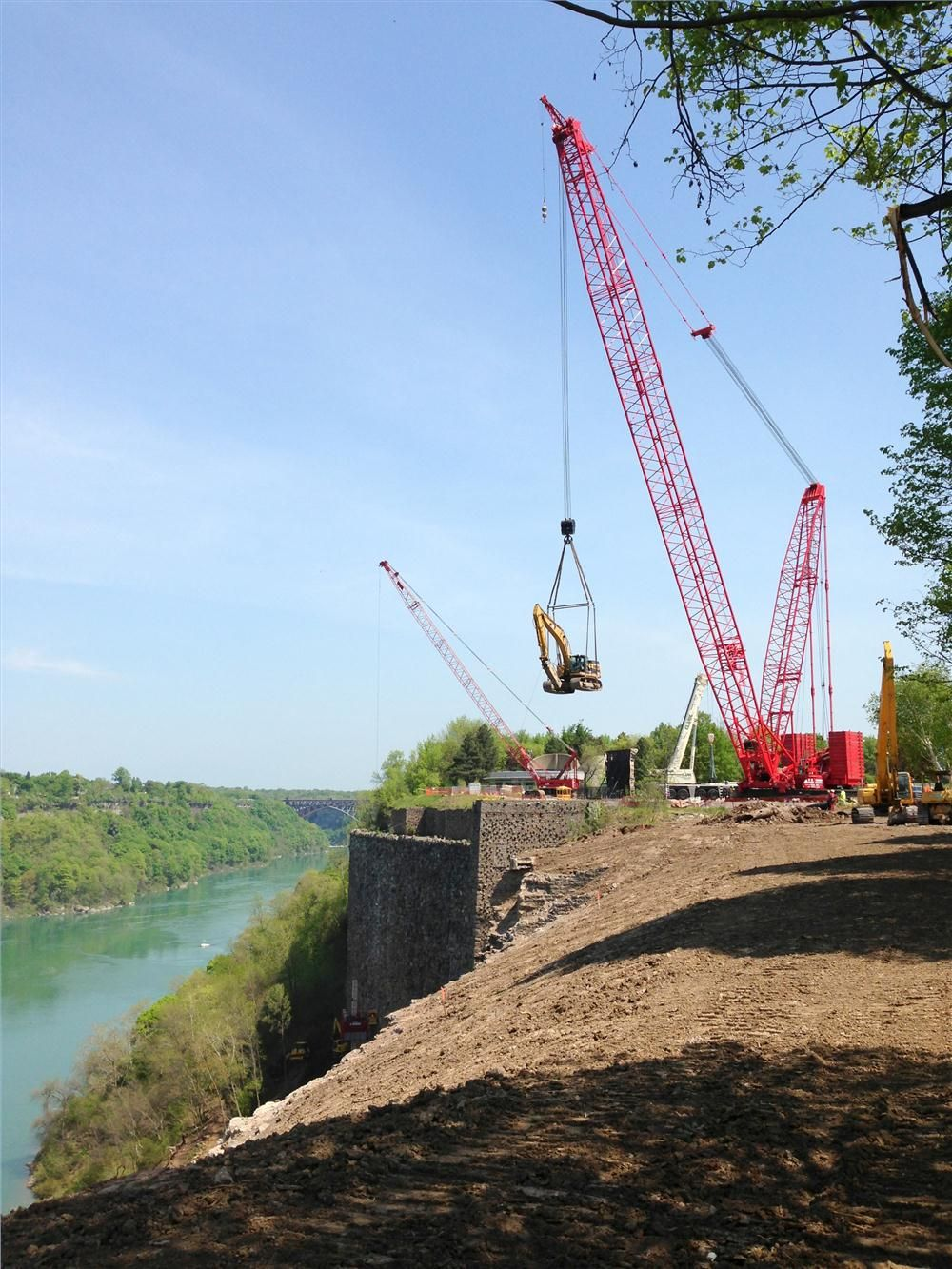 Configured with a 225-ft. (69 m) boom, the crane was situated within working distance of the top of the gorge and effortlessly lifted and lowered heavy equipment to the work site below.