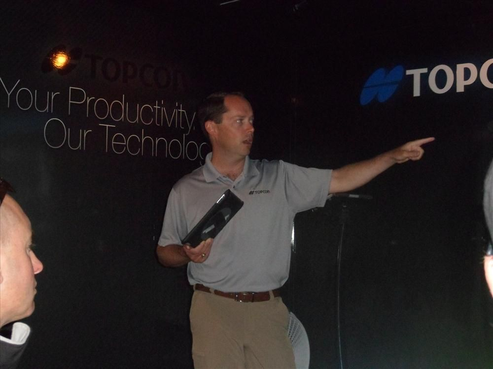 Scott Langbein, director of Channel Marketing, Topcon Positioning Group, gives an information session in the Topcon trailer.