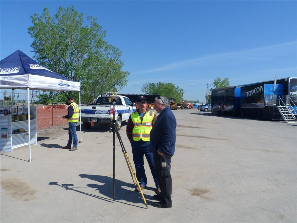 Jeff Moore (L), Parker Land Survey, was able to track down Topcon's Rand Black to get a one-on-one about the LongLink3, DS Robotic Total Solution and Hyper SR GPS with auto tracking.