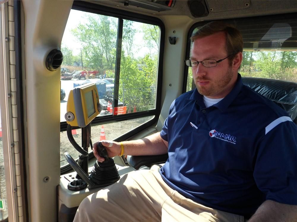 Admar Supply's Evan Spencer showed how the Topcon GX60 allows the contractor to grade, cut and fill while watching a screen.
