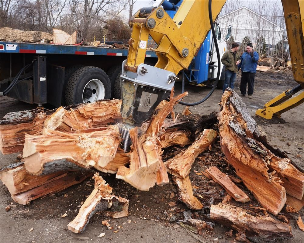 The S2X 800 tears apart a log at a product demonstration in Turnersville, N.J.