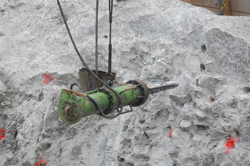 The bit or shaft of the rock splitter is placed inside a hole that has been drilled in the surface of the rock.