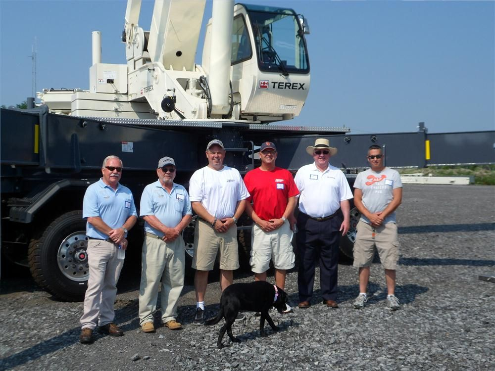(L-R) are Ernie Krupke and Ron Krupke, both of Pauli Cranes; Paul Lonergan and Luke Lonergan, owners Empire Crane; David Naab, Terex; and Caleb Dillensneider, Deerfield Valley Crane, in front of the Terex Crossover.