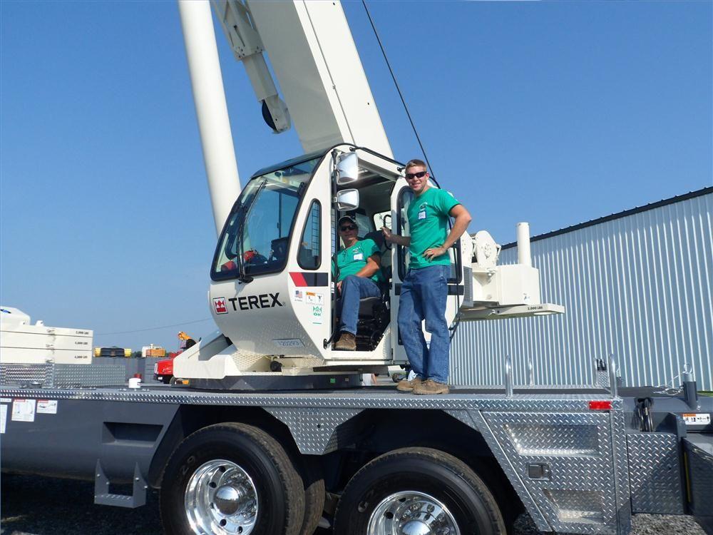 Gregg (L) and Tom Eldridge, both of Payne's Cranes, Bainbridge, N.Y., check out the new 80 ton (72.5 t) Terex T780.