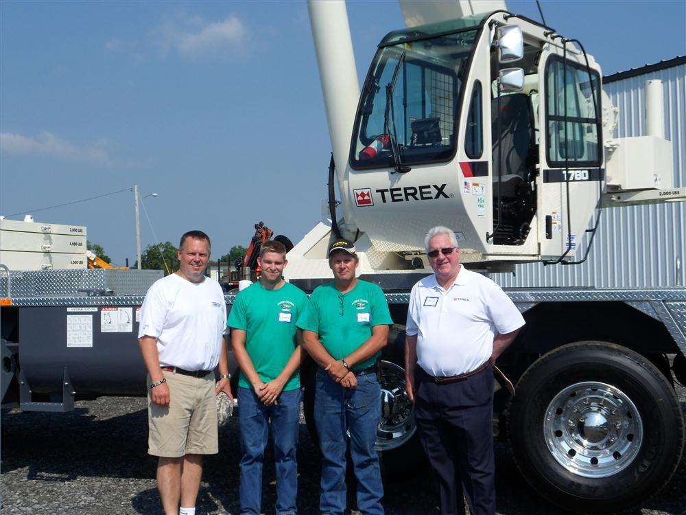 (L-R) are Paul Lonergan, Empire Crane; Tom Eldridge and Gregg Eldridge, both of Payne's Cranes; and David Naab, Terex, in front of the Terex T780.