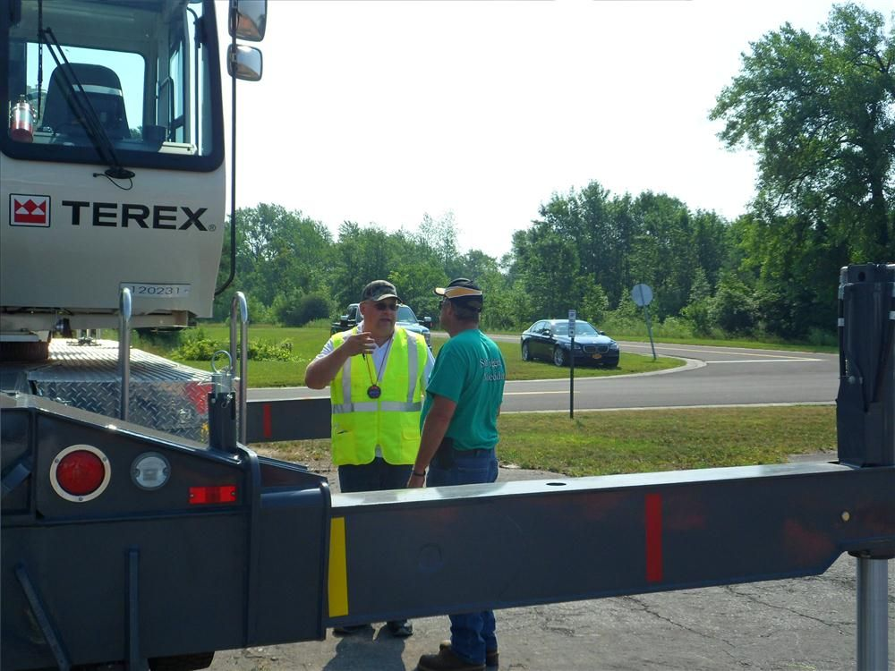 Henry Vrozyna (L), of Columbus McKenna, gives instructions about the rodeo to Gregg Eldridge of Payne's Cranes.