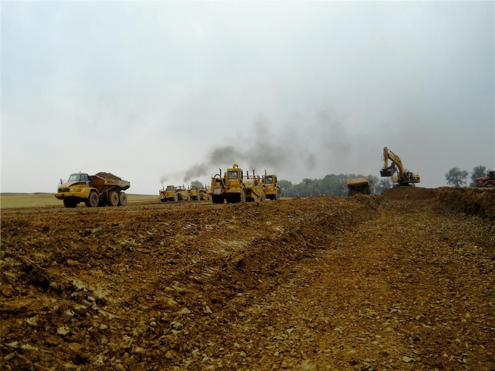 In order to perform the work, LCD relied on The H&K Group's massive fleet of earthmoving equipment.  The arsenal consisted of Cat excavators, rock trucks, scrapers and bulldozers. To meet compaction needs, it utilized Cat compactors, vibratory and s