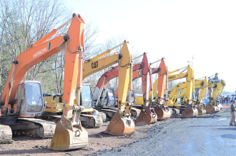 Excavators are ready to be auctioned off at the Hunyady sale.