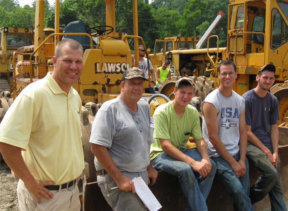 (L-R): Denny Burt of Rudd Equipment Company stopped by the auction to catch up with Joe Stewart of Stewart Construction; Gino Bioni of Bioni Industries; Kevin Hunter of Hunter Construction; and John Agostinella of Sopko Construction.