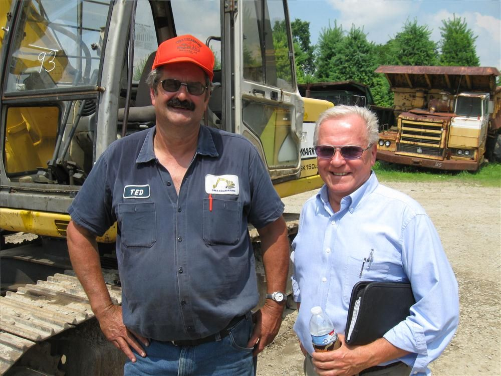 Ted Crea (L) of Crea Excavating swaps notes on the equipment with Anderson Equipment Company's Walt Kelley.
