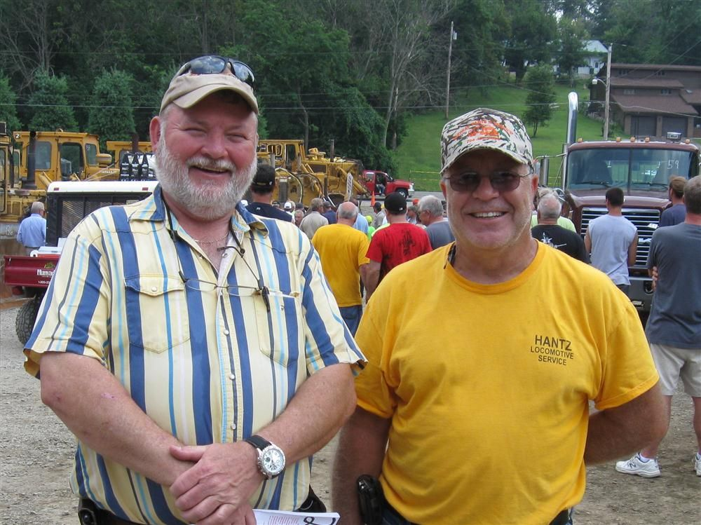 Tom Zimmerman (L) of Kukurin Contracting and Jim Battaglia of Dura-Bond Industries try to stay cool while taking in the auction.