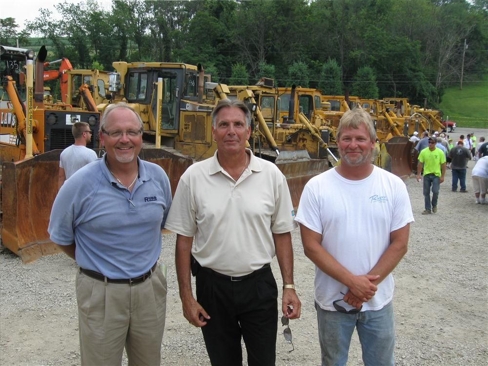 (L-R): Rudd Equipment Company's Ray Stevens and Mike Hammer talk with Darren Millington of Millington Excavating.