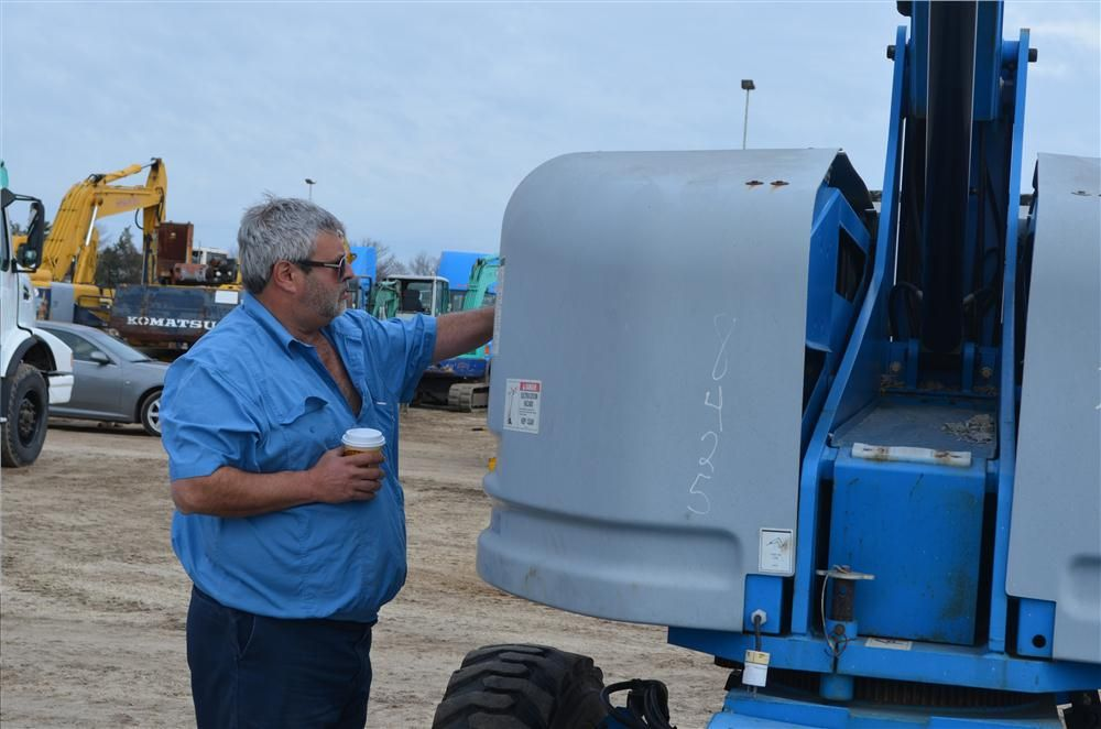 With a coffee in hand, Joe Demdis, owner of Demdis Sand and Gravel, Phelps, N.Y., is primed to check out equipment.
