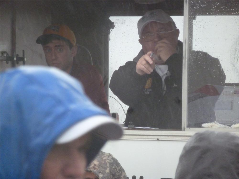 Jack Lyon stays dry as he takes bids on a Komatsu wheel loader.