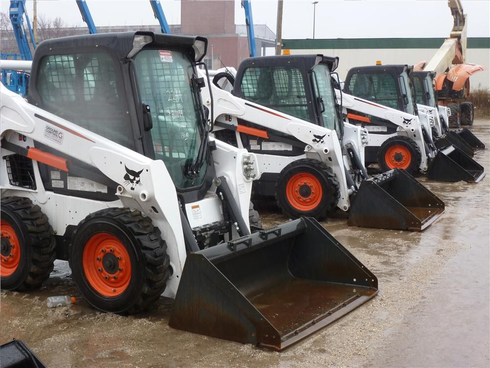 Bobcat skid steers await their turn on the auction block.