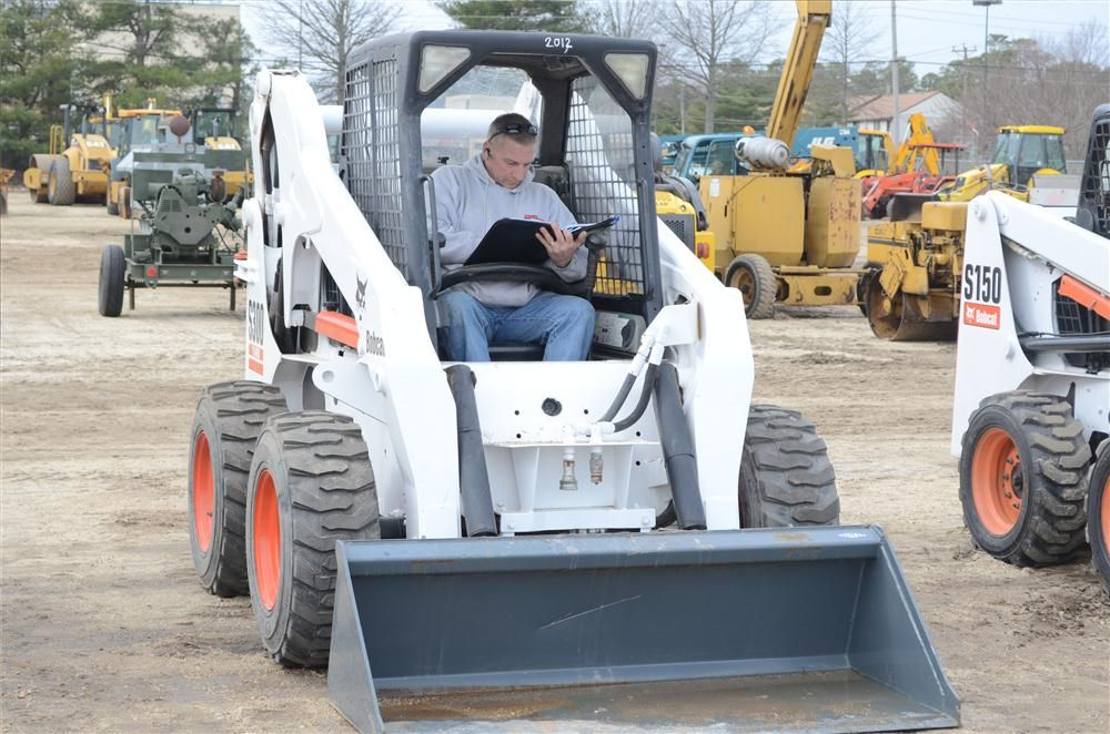 Marty Passara, owner of Advanced Irrigation, Palmyra, N.J., checks out a skid steer.