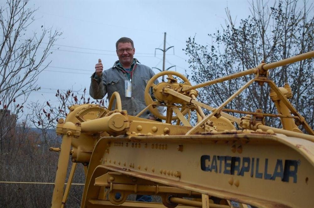 Jeff Fisher, of Fisher Construction in Liverpool, N.Y., reminisces about times past and this Cat model 12 grader.