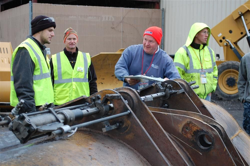 Milton CAT's service department demonstrates its onsite portable line boring.