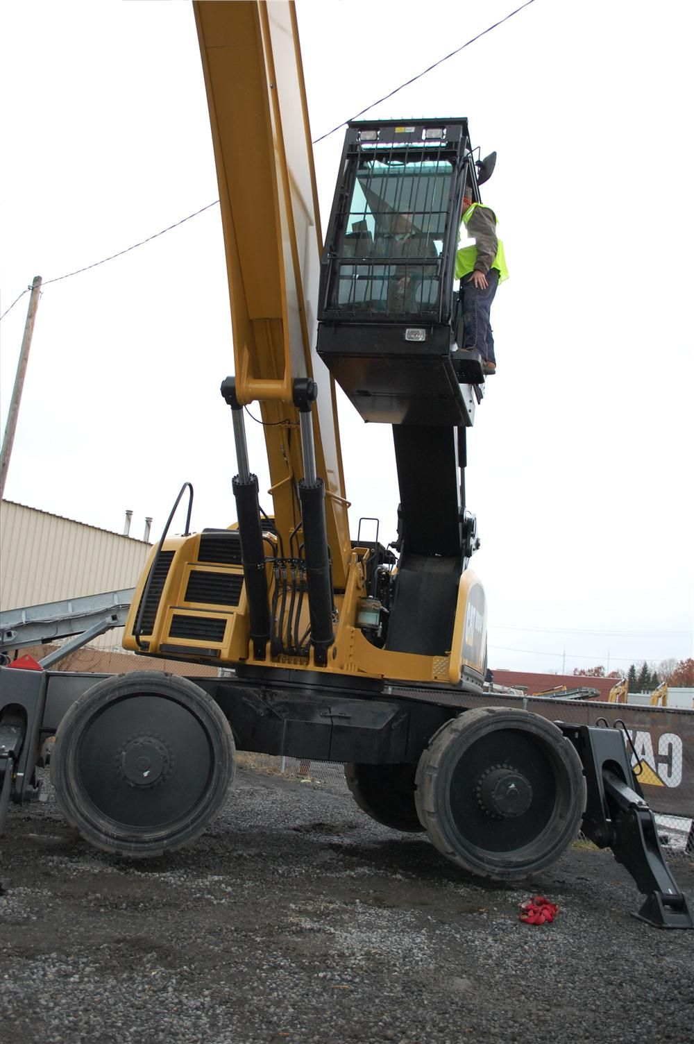 Visitors unfamiliar with scrap equipment still enjoyed the features of the Cat MH3049 material handling (scrap excavator) at work.