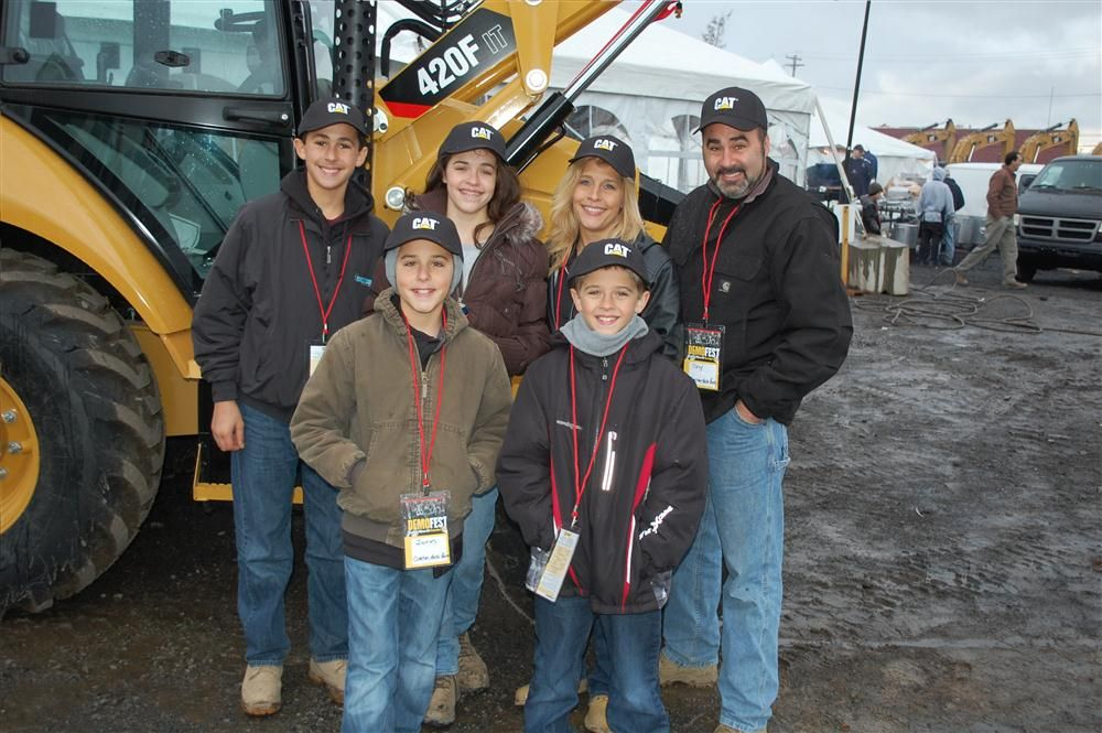 With a Cat 420F backhoe is Tony Mele and his family, representing Clinton Auto Parts in Buffalo, N.Y.
