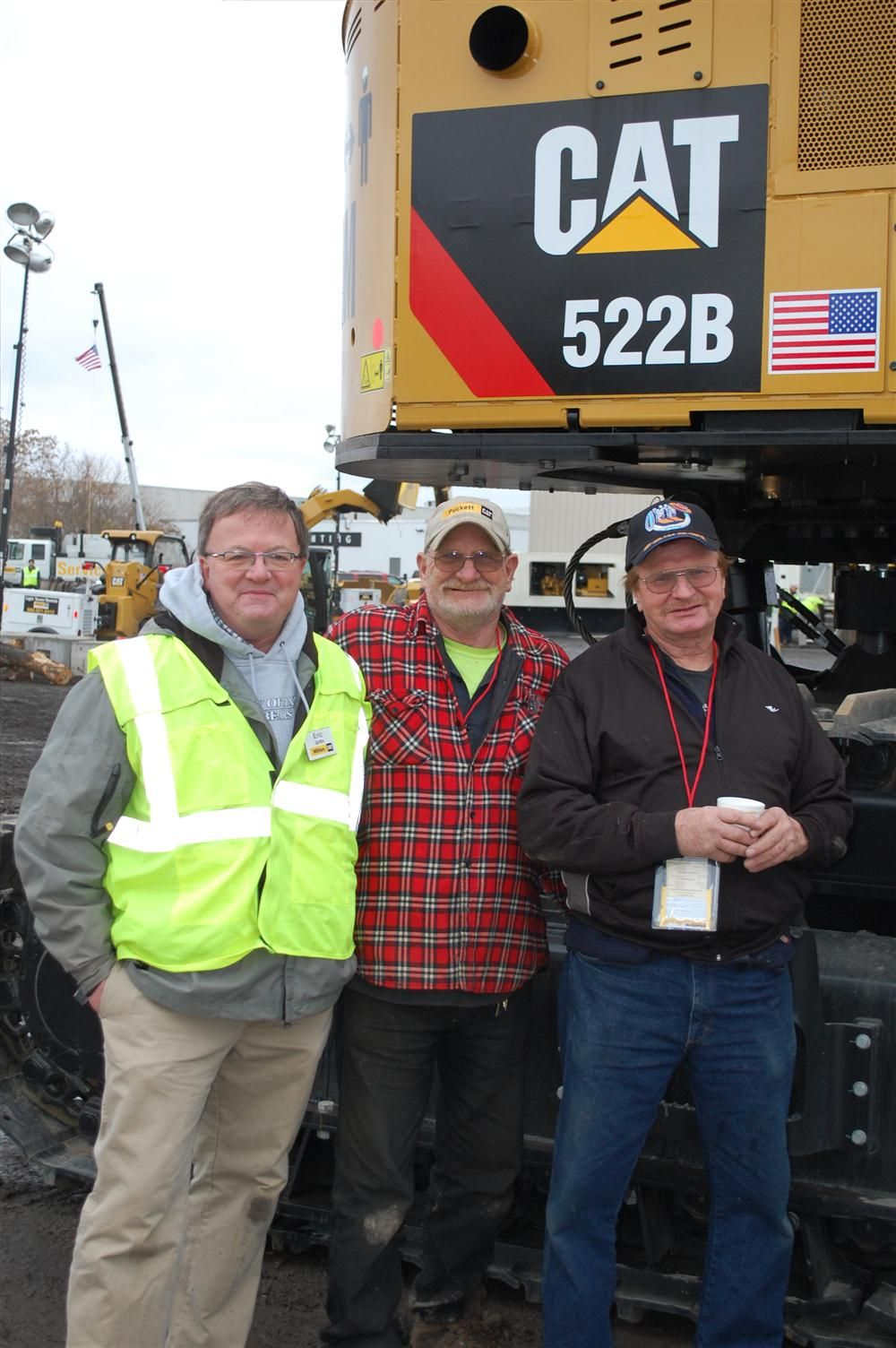 This group is being guided through a close inspection of the underside of a Cat 522B.  (L-R) are Eric Griffin of Milton CAT; Junior Raymond and Fred Groom of Slater Farms in Moravia, N.Y.