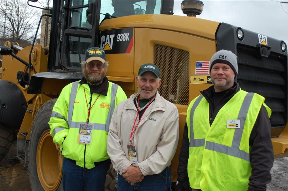 Representatives of Suit-Kote, one of the largest asphalt producers and paving contractors in New York State, are shown the features of the Cat 938K loader.  (L-R) are Harvey Anderson and Jim Fitzpatrick, both of Suit-Kote, and Jim Norstad of Milton CAT.