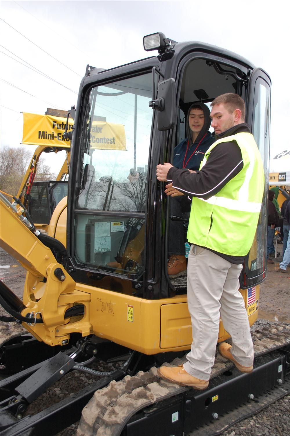 Junior operators were encouraged to check out the operation of Caterpillar's compact equipment. In the cab of a Cat 303.5 is Matt Delfuoco receiving training from Matt Brune of Milton CAT.