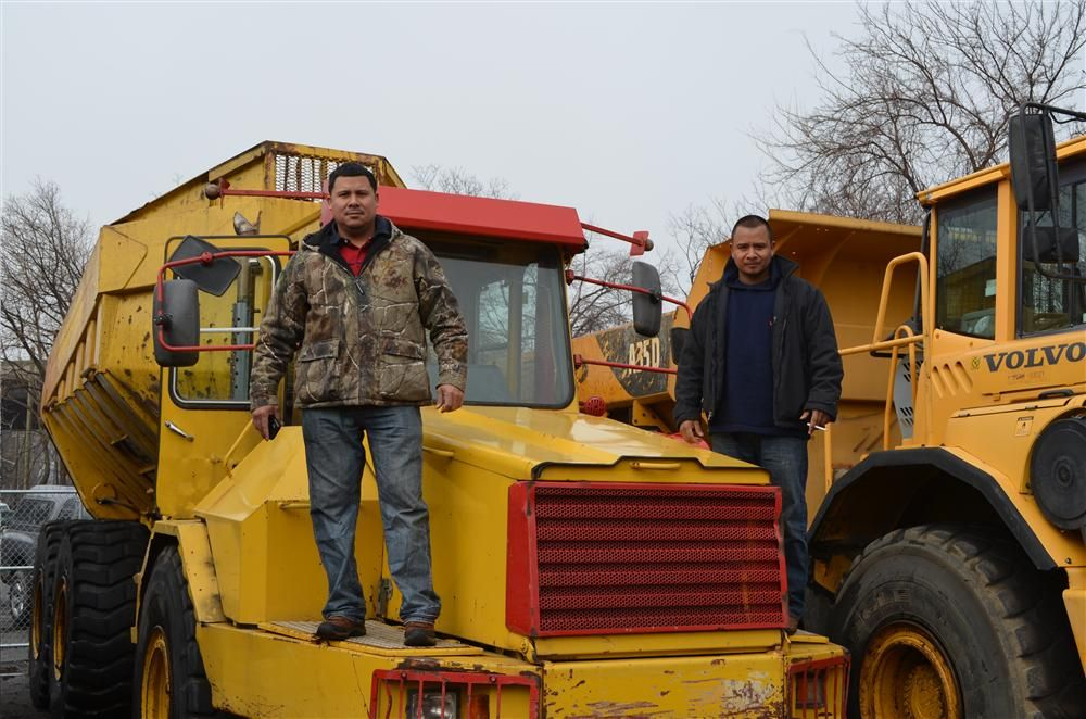 The Abalos brothers are ready to test equipment at the auction.