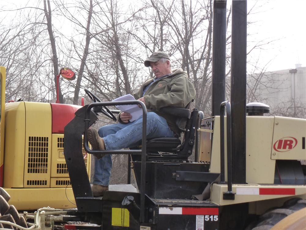 Chuck Kritch of Atlantic Crane, Farmingdale, N.J., records prices on an Ingersoll Rand roller.