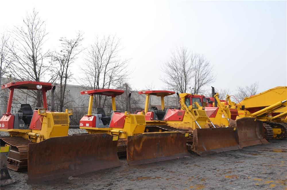 Painted with the Sanzari red, a row of crawler tractors sits ready to be auctioned off in Elmwood Park N.J.