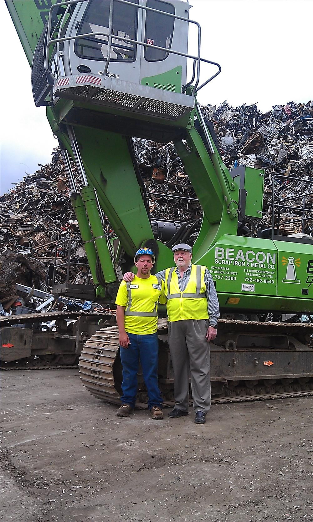 Representing the third generation of the family-owned Beacon Scrap Iron & Metal, Clyde Cameron III (L)  is joined by his grandfather, William Smith Sr., the founder of the company.