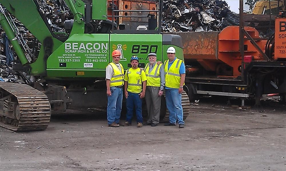 Welcoming the arrival of Beacon's new Sennebogen 830 R-HD are (L-R) Dominick Vecchiarelli, sales manager at Binder Machinery; Clyde Cameron III; William Smith Sr.; and Jim Gill, Binder Machinery's specialist in scrap processing equipment.