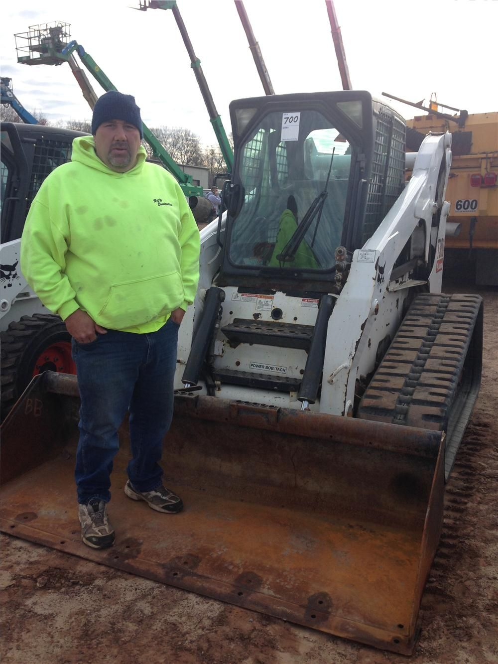 Ron Harrison of R & H Construction tests out a Bobcat skid steer.