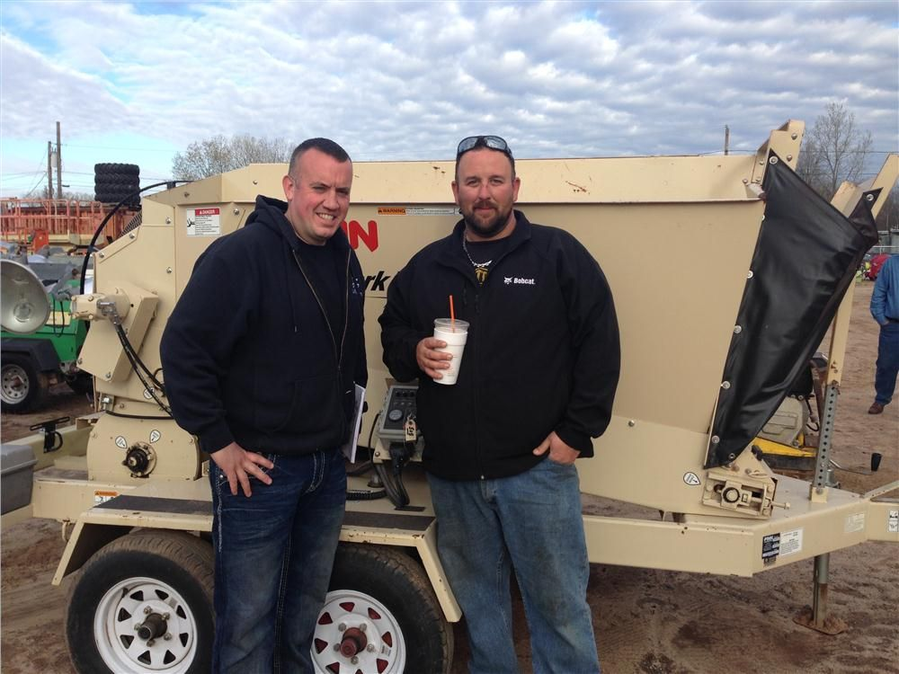 Joe Constantino (L) and Cameron Sickles of J & S in Woburn, Mass., in front of a Finn bark blower.