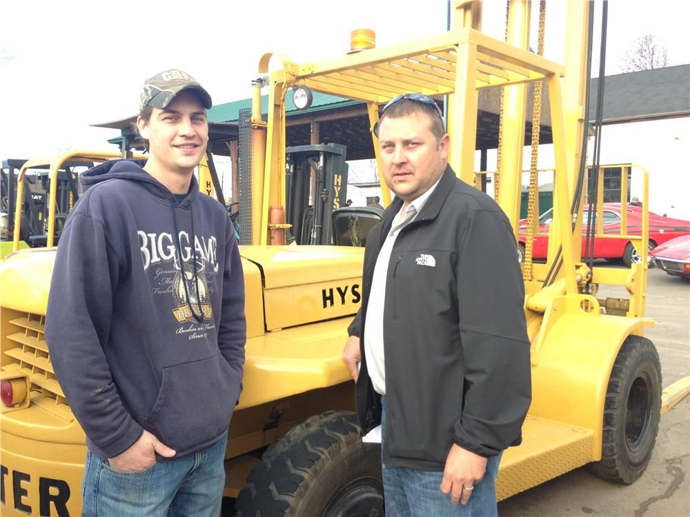 Mike Rasnake (L) and Phil Rasnake of Woodhams Equipment check out a Hyster forklift.